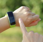 31592616 - smart watch on hand with empty screen on nature green background, screen is great for your design copy space