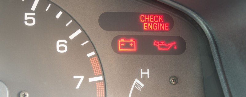 Car dashboard warning lights symbols showing check engine ,oil pressure , battery charge