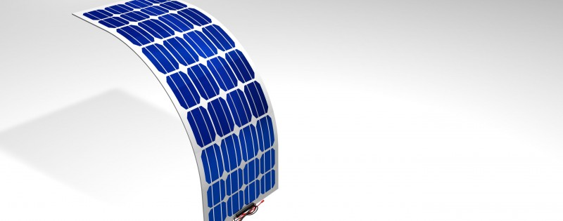 3D model of a flexible solar panel with black and red connection cables on white background - Renewable Energy - 3D Illustration